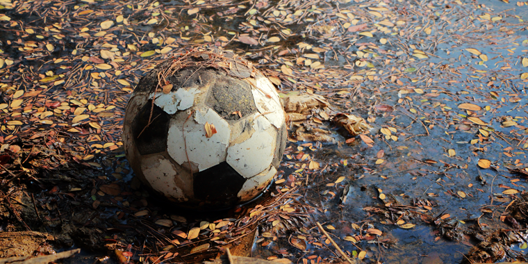 Why are reports of childhood sexual abuse in football rising?